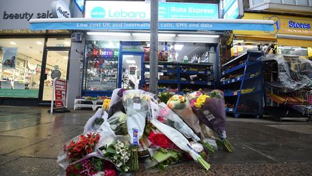 Tributes to Vijay Patel outside a shop on The Broadway in Mill Hill, north London. Picture: Kirsty O