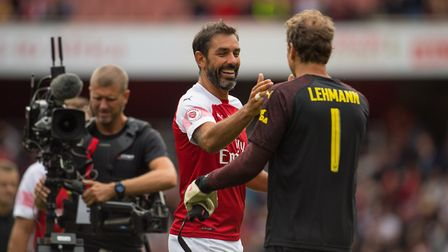 Arsenal Legends' Robert Pires (left) congratulates teammate Jens Lehmann at the final whistle of the