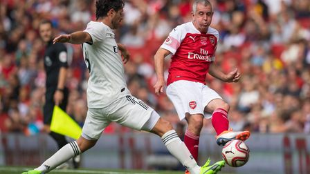 Arsenal Legends' Nigel Winterburn (right) is challenged by Real Madrid Legends' Fernando Sanz during