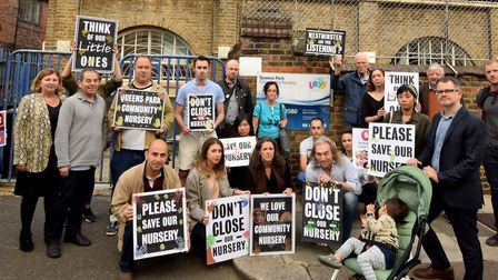Parents outside Queen's Park Community Nursery protest over the nursery's mid-year closure. Picture: