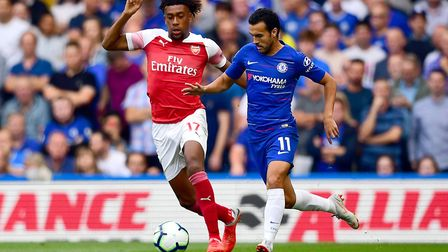 Arsenal's Alex Iwobi and Chelsea's Pedro battle for the ball during the Premier League match at Stam