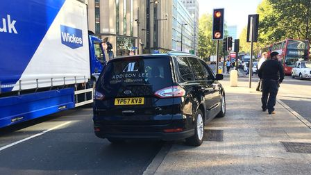 The Addison Lee cab in the Euston Road, whose driver had a suspected heart attack at the wheel. Pict
