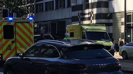 Emergency services in the Euston Road, where the cab driver had a suspected heart attack at the whee