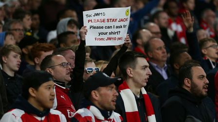 A young Arsenal fan holds up a message to Jack Wilshere in the UEFA Europa League game between Arsen