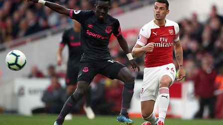 Everton's Idrissa Gueye (left) and Arsenal's Granit Xhaka battle for the ball during the Premier Lea