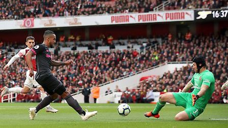 Everton's Theo Walcott (left) has a shot saved by Arsenal goalkeeper Petr Cech during the Premier Le