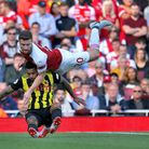 Arsenal's Shkodran Mustafi (right) and Watford's Andre Gray battle for the ball during the Premier L