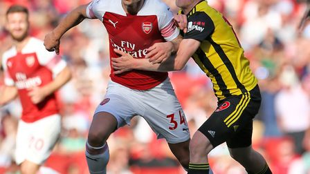 Arsenal's Granit Xhaka (left) and Watford's Will Hughes battle for the ball during the Premier Leagu