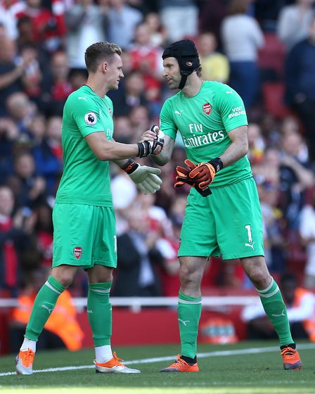 Arsenal goalkeeper Petr Cech (right) is replaced by team-mate Bernd Leno after picking up an injury