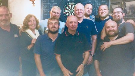 The darts team from Camden's Golden Lion face the camera