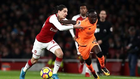 Arsenal's Hector Bellerin (left) and Liverpool's Sadio Mane battle for the ball (pic John Walton/PA)