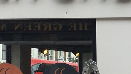 An apparent bullet hole in the sign of an Essex Road kitchen showroom following Thursday's gunfire.