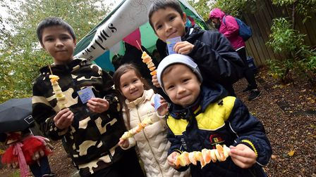 Making fruit kebabs, the Karaman family from left Ali, Kaussar, Mukhtar and Almasbek. Picture: Polly