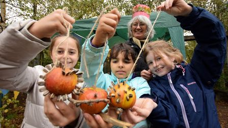 Making apple bird feeders with Hilary King volunteer at the Garden Classroom, pictured from left Ani