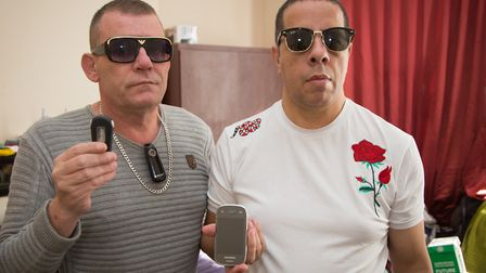 Andrew William-Coleman (grey t-shirt) and Gustavo William-Coleman holding alarm devices after violen
