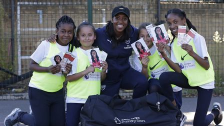 Danielle Carter of Arsenal visits Christ the King RC Primary School in North London for the Premier
