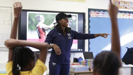 Danielle Carter of Arsenal visits Christ the King RC Primary School in North London (pic Henry Brown