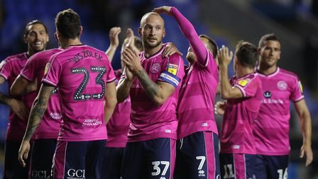 Queens Park Rangers's Toni Leistner (centre) is congratulated by his team mates after the win at Rea