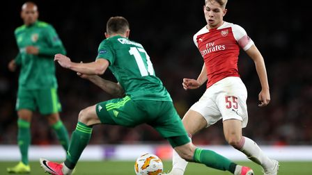 Vorskla's Volodymyr Chesnakov (left) and Arsenal's Emile Smith Rowe battle for the ball (pic Nick Po