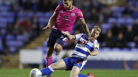 Queens Park Rangers's Nahki Wells (left) is tackled by Reading's Josh Sims (pic Andrew Matthews/PA)