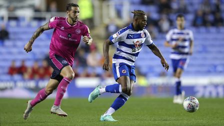 Reading's Leandro Bacuna (right) gets away from Queens Park Rangers's Geoff Cameron (pic Andrew Matt