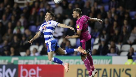 Reading's Liam Kelly (left) and Queens Park Rangers's Angel Rangel battle for the ball (pic Andrew M