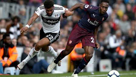 Fulham's Cyrus Christie (left) and Arsenal's Danny Welbeck battle for the ball during the Premier Le