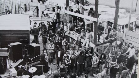 A concert at the adventure playground during a WCPA festival in the 1970s, with Hocking Hall in the