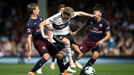 Fulham's Andre Schurrle (centre) and Arsenal's Nacho Monreal (left) battle for the ball during the P