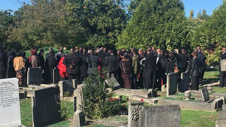 Mourners gather at Dame Betty's graveside at Alperton Cemetery. Picture: Nathalie Raffray
