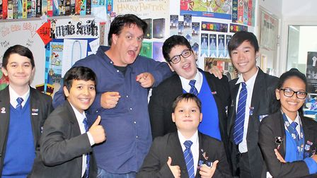 Author Andy Briggs with St Augustine CofE pupils.