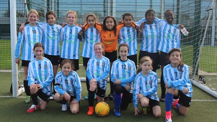 The Brent under-12 girls' football team face the camera (pic: Brent Schools' FA)