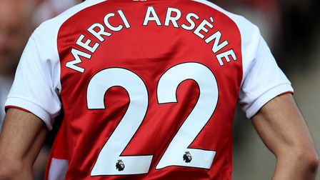 A fan wearing a shirt honouring outgoing manager Arsene Wenger before the Premier League match at th