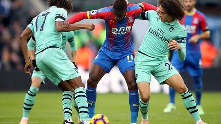 Arsenal's Alex Iwobi (left) and Matteo Guendouzi (right) battle for the ball with Crystal Palace's W