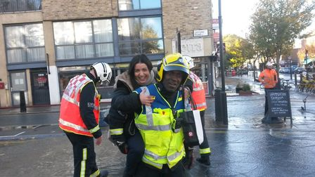 A fireman gives a lift to a stranded passer-by on Monday. Picture: Paul Convery