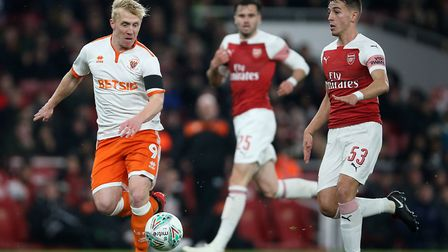 Blackpool's Mark Cullen (left) and Arsenal's Julio Pleguezuelo battle for the ball (pic Nigel French