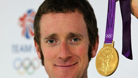 Wiggins poses with one of his five Olympic golds Picture: Andrew Milligan/PA