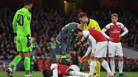 Danny Welbeck of Arsenal lies injured during the Europa League match at the Emirates Stadium. Pictur