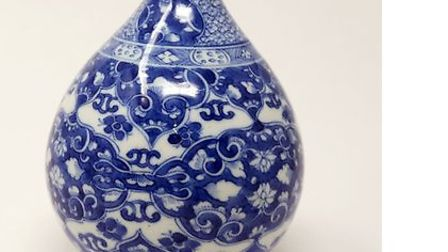 Chinese Kangxi period blue and white vase decorated in floral design which sold for £1,100 and a lat