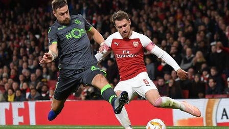 Aaron Ramsey of Arsenal crosses during the Europa League match at the Emirates Stadium. Picture by M