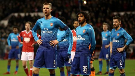 Arsenal's Per Mertesacker and Mohamed Elneny react during their FA Cup loss at Nottingham Forest (pi