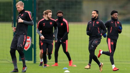 Arsenal's Per Mertesacker (left) and Theo Walcott (second right) during a training session at London