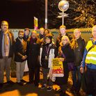 Residents gather on the bridge between Kendal Road and Gladstone Park for a show of strength against