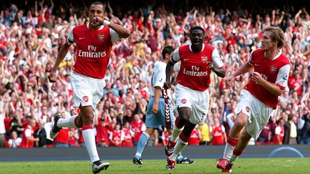 Gilberto Silva (left) celebrates his equaliser against Aston Villa, the first competitive goal at th