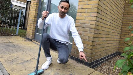 Arfan Qureshi points to the scene of the crime on his doorstep. Picture: Polly Hancock