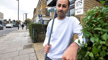 Arfan Qureshi outside his Balls Pond Road home where he was bottled. Picture: Polly Hancock