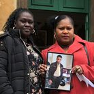 Jessica Plummer holding a picture of her son Shaquan. On her left is Jenny Appleton whose son Stefan