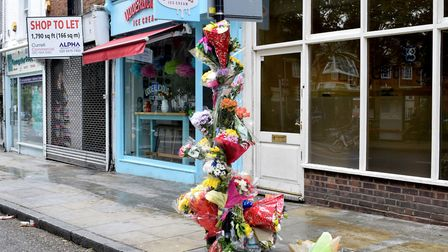 Floral tributes left at the scene of Marcel Campbell's stabbing in Upper Street. Picture: Polly Hanc
