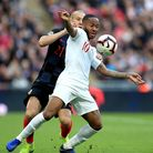 Croatia's Domagoj Vida (left) and England's Raheem Sterling (right) battle for the ball during the U