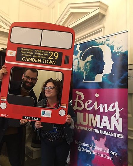 Dr Petros Kararsareas and Athena Mandis posing with a 29 bus cut out. Picture: Being Human Festival